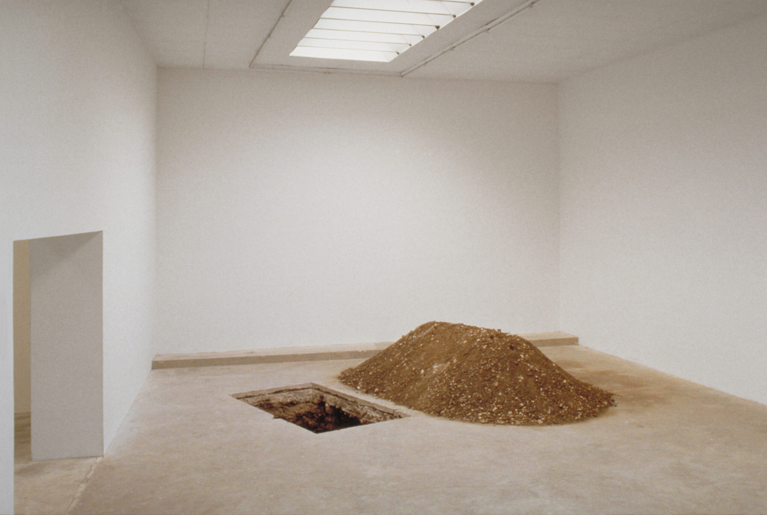 Maurizio Cattelan, Untitled, 1997, Rectangular hole, pile of removed earth  200 x 100 x 150 cm, Installation view, Le Consortium, Dijon, 1997  Courtesy Maurizio Cattelan's Archive  Photo André Morin