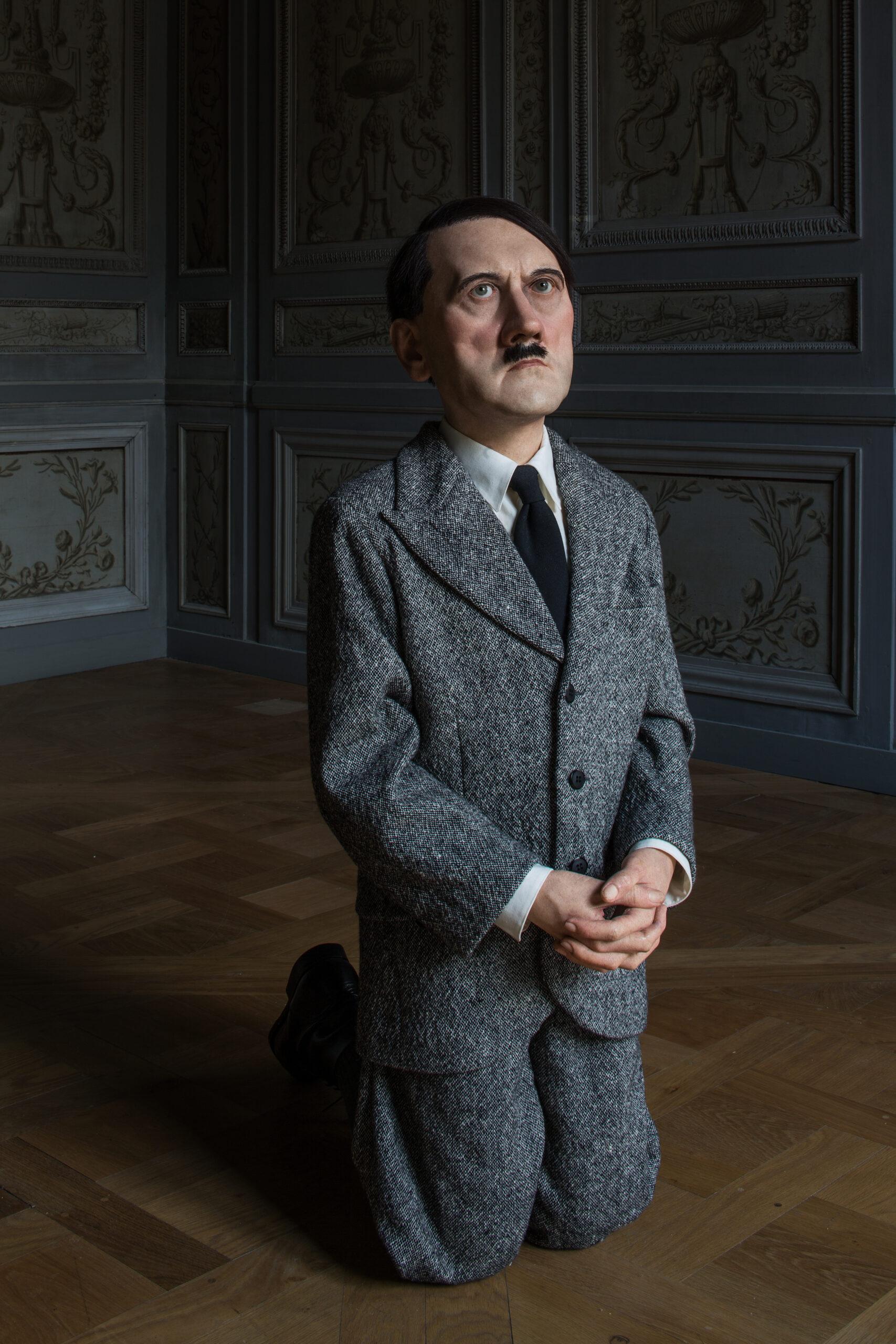 Maurizio Cattelan, Him, 2001, Wax, human hair, suit, and polyester resin, 101 x 41 x 53 cm  Installation view, Monnaie de Paris, 2016. Courtesy Maurizio Cattelan's Archive  Photo Zeno Zotti