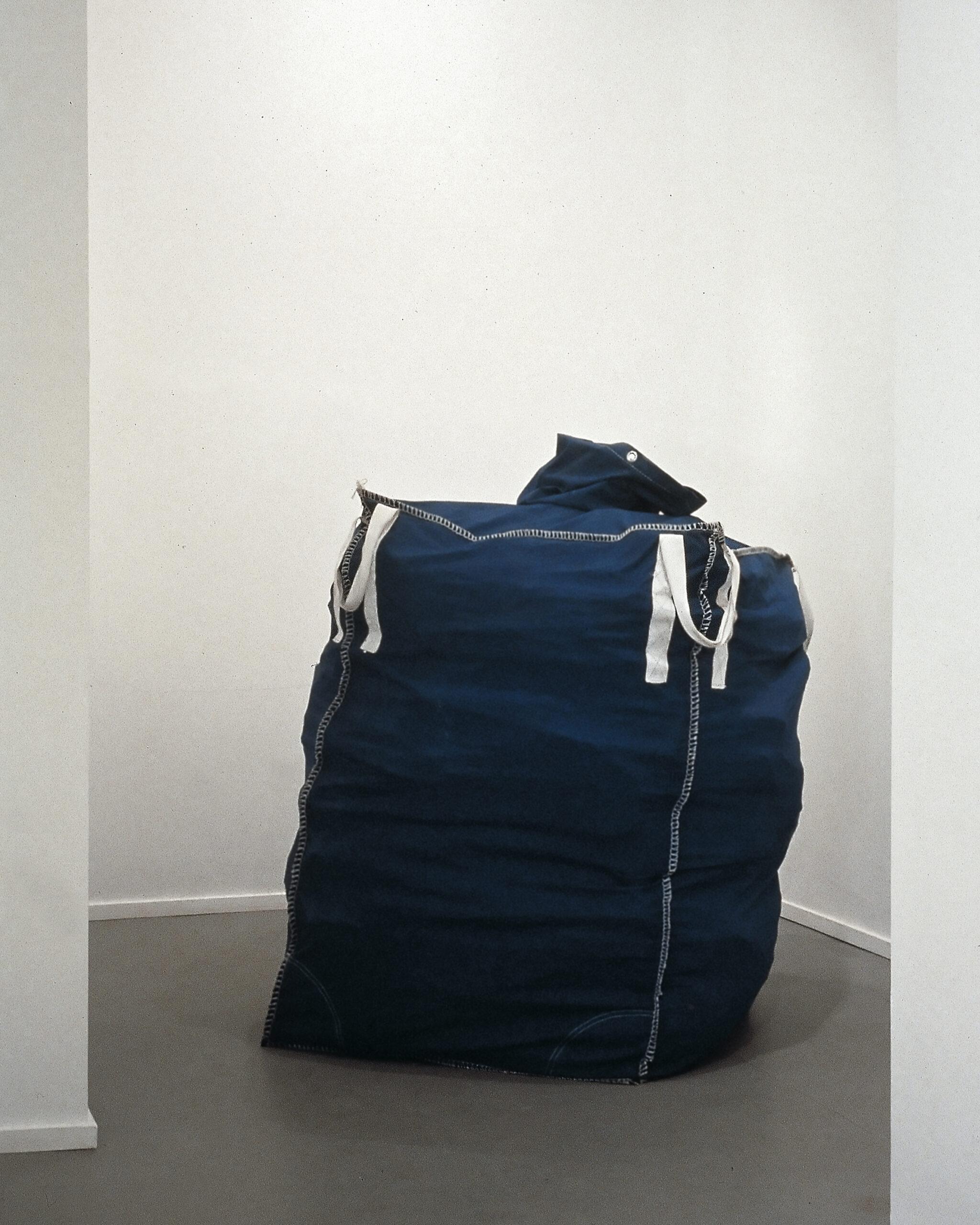 Maurizio Cattelan, Lullaby, 1994, Fabric, rubble, 135 x 85 x 85 cm  Installation view, Laure Genillard Gallery, London, 1996  Courtesy Maurizio Cattelan's Archive